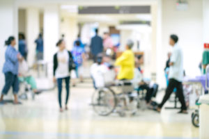 blurred image of patients and visitors in hospital lobby