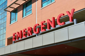 exterior of building with red emergency sign